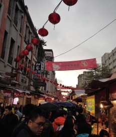 People in Dihua street buying traditional meals.